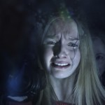 """(L to R) Rebecca (OLIVIA DEJONGE) hides from Nana (DEANNA DUNAGAN) in Universal Pictures' """"The Visit"""".  Writer/director/ producer M. Night Shyamalan returns to his roots with the terrifying story of a brother and sister who are sent to their grandparents' remote Pennsylvania farm for a weeklong trip.  Once the children discover that the elderly couple is involved in something deeply disturbing, they see their chances of getting back home are growing smaller every day."""